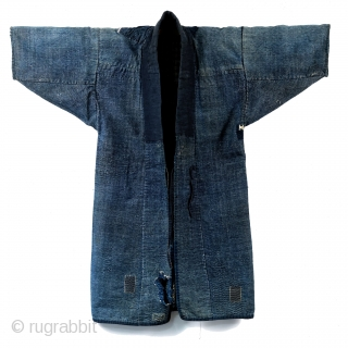 Boro Noragi - Meiji-era Indigo Cotton and Hemp Blend.  Thick, handspun indigo noragi with many mending patches.   This jacket is heavy and warm and shows many, many years of use, but it still  ...