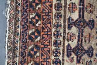 "Baluch balisht, size 18.5"" x 36"", old, battered but interesting, the knots are symmetrical, it has a two cord selvedge, the foundation is an extremely fine, hand-spun wool, the foundation is in  ..."