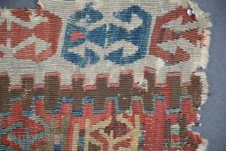 """This is an extremely old, much battered Anatolian kilim fragment (15"""" x 38"""" +/-), tentatively attributed to Central Anatolia, the style of several of its motifs is suggestive of considerable age, the  ..."""