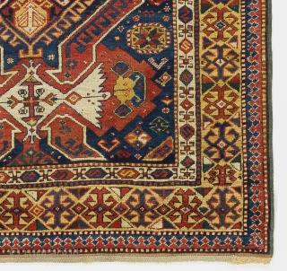 a handsome Kuba rug from North East Caucasus with shield, arms and dragons on a beautiful indigo blue ground framed by a rare yellow border. Very good condition with full pile and  ...