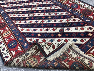 """An outstanding Gendje long Rug with diagonal stripes, Caucasian Mountains, ca 1900.  Very good condition with lustrous full pile. 3'9"""" x 8'  (115x245 cm), no 4591."""