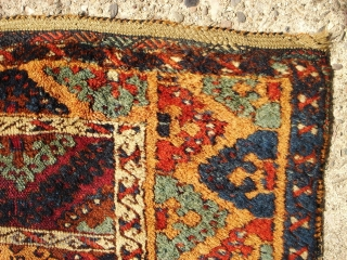 Anatolian Kurdish Yoruk rug. 50X79 Inches... 127X201 Cm. All intact with braided ends. Mostly good pile, some wear, dirty with washable stain and a crease cut as shown.