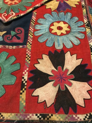 An exceptional example of an antique Uzbek Lakai Tribe silk embroidered Ilgich / Ayna Khalta hanging with false flap dating to the last quarter of 19th century. This large envelope shaped is  ...