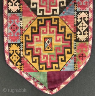 An outstanding example of Antique Uzbek Lakai tribe silk cross stitched shield shaped talismanic hanging known as Uut Kap Ilgich, dating to the 19th century. This is one of the best examples  ...