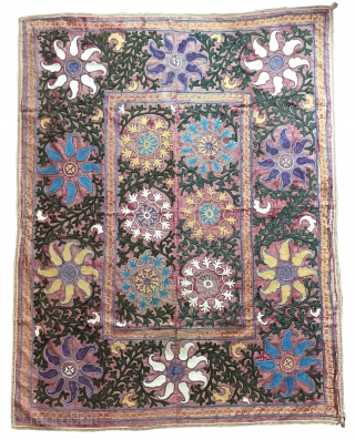 A beautiful and very decorative antique Uzbek Shahrisabz silk embroidered suzani. It dates to the late 19th century - early 1900s and it is a very unusual example. The fine polychrome silk  ...