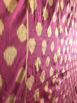 A visually dazzling antique Uzbek silk on silk Ikat hanging from Bukhara dating to third quarter of the 19th century. It is silk warp and silk weft Abr Ikat with a lovely  ...