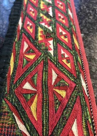 An exceptional antique Tekke Turkoman / Turkmen chyrpy or coat silk embroidered collar. It dates to the 19th century and it is an exceptional demonstration of the coveted Tekke tribe's embroidery art.  ...