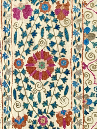 A majestic antique Uzbek silk suzani from 19th century Bukhara. This rare example boasts a magnificent and very elegant design. The lattice field contrasts beautifully with the intricately drawn free flowing floral  ...