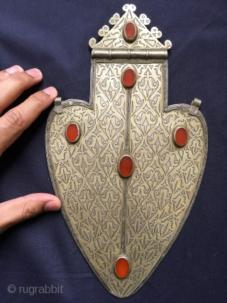 A majestic large Antique Turkoman / Turkmen gilded silver Asyk pendant and carnelian inset. This museum grade example was made by the Tekke / Teke tribe and dates mid to third quarter  ...