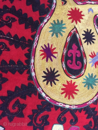 An exceptional Antique Uzbek Lakai Uut kap Ilgich embroidered Suzani. This shield shaped embroidery dates to late 19th century and is an outstanding example.  The fine embroidery is executed with fine  ...
