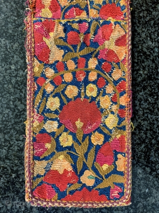 An exceptional antique fully silk embroidered Uzbek Bridal hair braid cover dating to the 3rd quarter of 19th Century. It is fully silk embroidery using very fine basma stitch. Often these are  ...