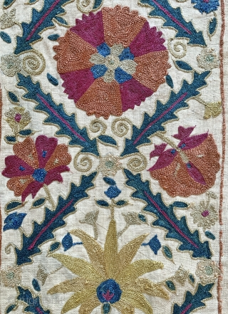 An excellent antique Uzbek silk suzani from Nurata dating between mid and early 3rd quarter of 19th century. Boasting a rich floral field design embroidered using fine polychrome silks chain-stitched on a  ...
