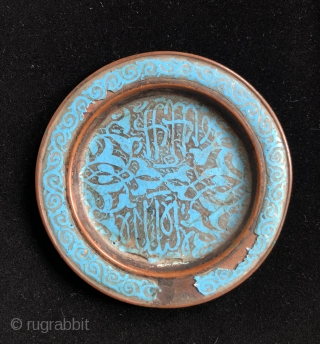 Copper alloy plate with turquoise colored enamel and Islamic script.  Turkestan, 17/18th century.  Size: 4.5 inches in diameter.