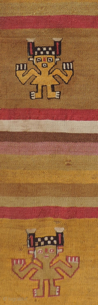 Standing figure detail from pre-Columbian tapestry.  Very finely woven Chancay panel with strong, minimal design.  Almost like tissue paper. Colors are intense and side selvedges intact. Good size. 20.5 x  ...