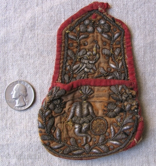 One of a kind small Colonial period pouch. Bolivia, 18th century.  Silver wrapped silk thread embroidery on a silk velvet ground that shows a Spanish (Europeanized) idealization of an indian with  ...
