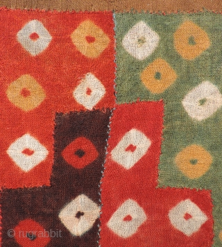 Beautiful, small Pre-Columbian tie-dyed textile. This is a very colorful and enduring object of ancient textile art dating from A.D. 400 - 800.  It has been conserved  ...