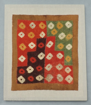 Beautiful, small Pre-Columbian tie-dyed textile. This is a very colorful and enduring object of ancient textile art dating from a.d. 400 - 800. It has been conserved to a neutral linen backing  ...