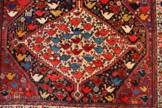 Beautiful antique Khamseh chicken rug, in full original pile, no repairs. All natural dyes despite appearances to the contrary.