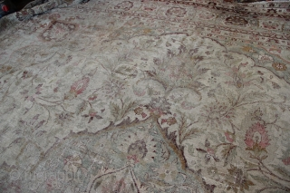 "Giant pale Amritsar carpet 600 x 552 or 19'6"" x 16'10"" Very worn allover,no actual holes. Fantastic 'look', with colours of cream, olive and deep magenta."