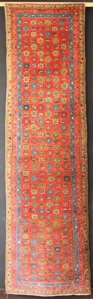"Early 20th century Heriz runner with an unusual design of birds and flowers on a rich brick ground. Full pile, no repair. 3'0""-3'2"" x 10'6"""