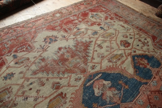Beautiful old serapi with some heavy wear and holes. Could be used as is or great restoration project. 11' x 14'