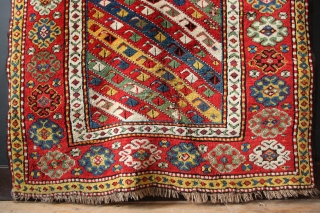 "Richly coloured Karabagh rug ca 1890, in full pile. 4'1"" x 6'10"" Beautiful, saturated natural dyes. Three wrinkle cuts and a largish corner reweave, rug lies flat."