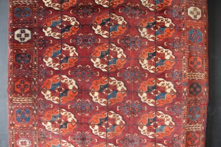 Beautiful mid 19th century Tekke main carpet fragment. Cut and rejoined through the middle and at one end. Somehow it works as a rug- it has full pile, beautiful wool and rich  ...