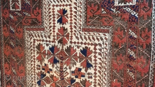 Antique Baluch prayer rug. Glossy camel field with saturated madder red in high relief, deep indigo highlights, and heavily oxidized browns, combining to form a rug of striking, sculpted presence.  Displays  ...