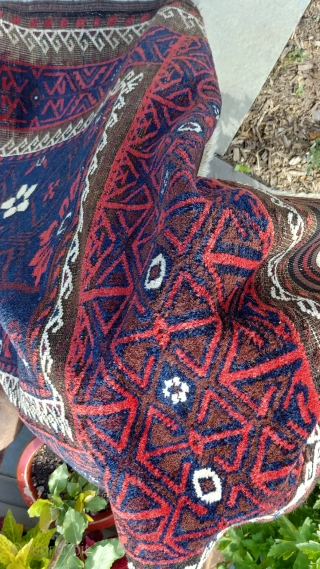 """Antique Mina Khani Baluch. 254cm x 90 cm (8'3"""" x 3') Cherry red and deep navy blue. Unusual borders with long knotted elems.  Camel wefts.  Corroded blacks in the border.  ..."""