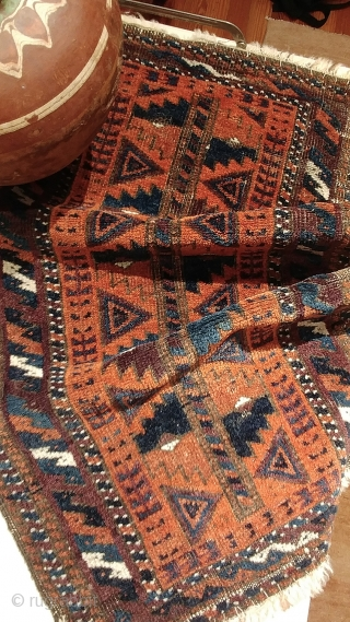 Antique Baluch balisht.  Fair condition with corroded browns, considered in the price.  Familiar, totemic design with striking presence and uncommonly good, saturated dyes.  Rust red, electric and navy blues,  ...