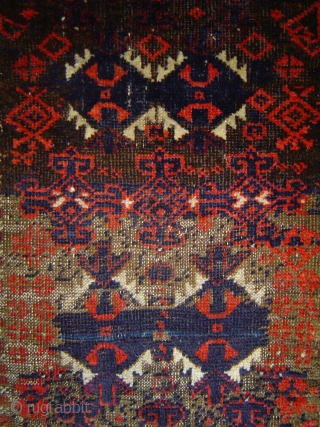 Baluch yastik, balisht, or pushti, 23 x 37.5 inches. A unique 19th century improvisation for the discerning collector. Wool and camel hair. Corroded browns. Sides mostly original finish, some re-wrapping. A few  ...