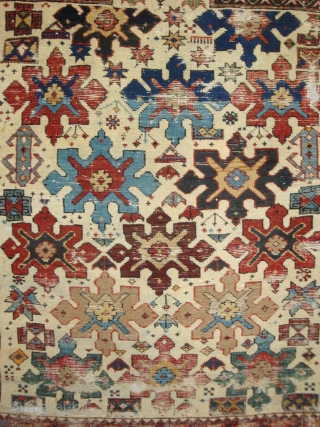 Shirvan 15 Snowflake Stars on Ivory. A 19th century prayer rug of petite dimensions. Camel hair and wool, some cotton weft. Numerous small holes and nicks, no restorations. A battle-scarred veteran of  ...