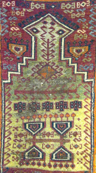 """East Anatolian prayer rug with rare """"Hittite Swastika Variant"""" border. Circa late 19th century. Rough spots, incomplete edges reinforced with old kilim pieces sewn on verso."""