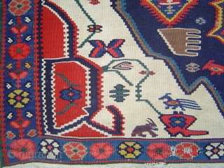 Bidjar kelim with superb colors and unique array of animal motifs. Missing top border replaced by sewn blue denim.