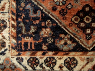 Small South Persian rug, probably Khamseh, with many intriguing features, including camels and a very attractive border. End losses and some ground showing, but overall in good condition. 1.40 x 1.08 m.