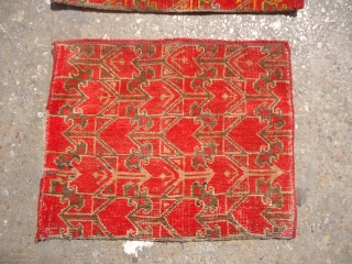 Unusual Khotan Bagface pair with original kilim backing,all original,nice colors  and condition.E.mail for more info and pics.