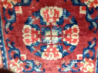 "For sale is  a Tibetan, 2'2""x 2'2"" early 20thCentury rug. Rug has good pile but with moth areas, some weft and warp breaks. Ends and sides are present. Cotton warp and  ..."