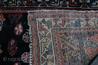 {90} 71 x 55 cm. Luri bag face with unique outer border design at top. Cotton warp and weft, some wear upper left field. Vertically elongated swastika guls framed by blossom arches.  ...
