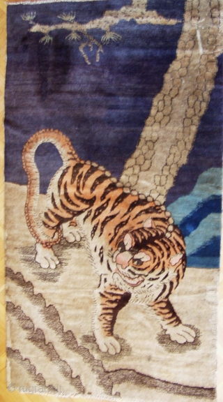 Early 20th century Baotou tiger rug. They are generally associated with tantric rituals whilst Chinese tiger rugs celebrate the fierceness and courage of the tiger as the protector against demons and evil  ...