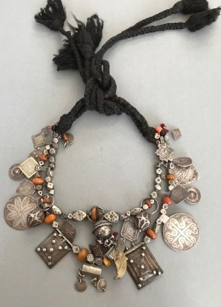 A designed necklace with very good old silver  components from Morocco. Put together probably back in the 60's with antique components not newly designed.