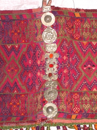 Embroidery of cross stitch  with original vegetable block printed back, and silver , carnelian ornamentation , wrapped gold threaded silk tassels and  knots from Uzbekistan used by Turkoman or Uzbek  ...