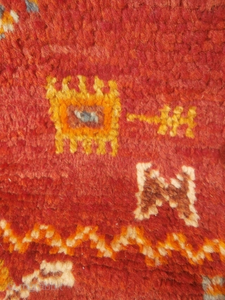 MOROCCAN HIGH ATLAS BERBER CARPET, an old and rare piece in excellent condition which is from the Ait Tamassine Berber group. The weaver has included in her random designs depictions of traditional  ...