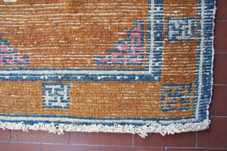 Here's a small, honest Tibetan khaden: nice tobacco color with good abrash, circa 119 x 67 cm, no repairs. An asymmetric benevolent cloud marks the sitting point, where pile is low as  ...