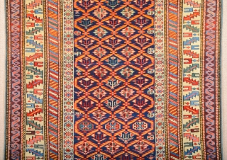 a blue-ground Kuba displaying a lattice design of yellow serrated leaves enclosing flowering shrubs. Mid 19th Century Shirvan Kuba Rug It has a nice pile on it. Lovely colors Size 110 x  ...