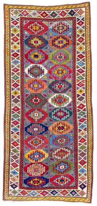 Mİddle of 19th Century South East Caucasian Moghan Rug.The striking, hooked stepped polygon filling each of the 24 compartments in the two-row composition of this Moghan is known as a Memling gül.  ...