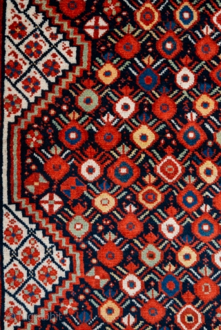 Second half 19th century South West Persian,Khamseh Rug This very beautiful Khamseh woven by a Baharlu/Ainalu tribal group features a dense repeat of pomegranates in brilliant and diverse colours against a midnight blue  ...