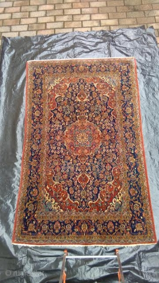 220 x 135 cm. is the size of this antique Kashan Persian carpet.