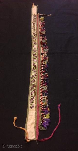 "Old Uzbek silk tassel ethnic and tribal collectible tassel hanging decorative tassel  Size: 80 cm x 8 cm Tassel height: 3 cm  100% handmade  VINTAGE UZBEK TASSELS : ""Segusha""( Triangle) is a decorative embellishments, whose function, was  ..."