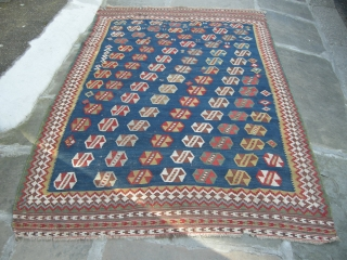 Antique qashgai kilim, approx 8ft x 5ft6. generally in reasonable conditon a few old repairs and minor stains. Fresh from a country sale.Very pretty well balance weaving