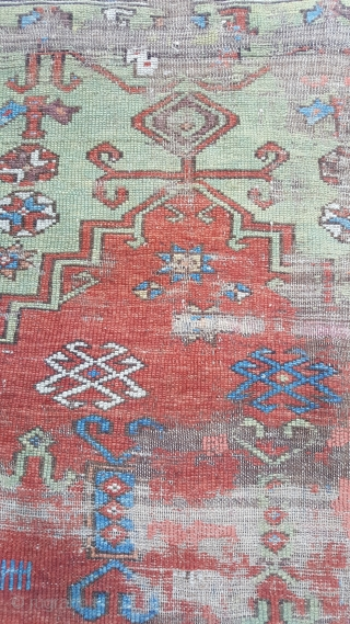 A small antique Konya prayer rug very worn with missing bottom boder but a charming antique rug.Needs a clean just found. 120x100 approx. Price does not include shipping which will be about 35usd  ...